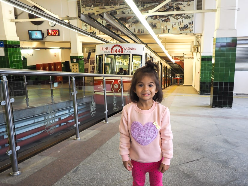Riding the Tunel funicular railway in Istanbul with children