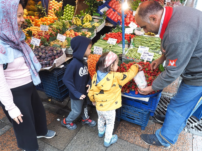 Visiting Kadikoy produce market with kids on the Asian side of Istanbul