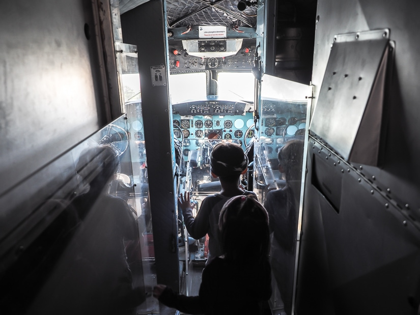 Our kids in the cockpit of an airplane at Rahmi M. Koc Museum in Istanbul