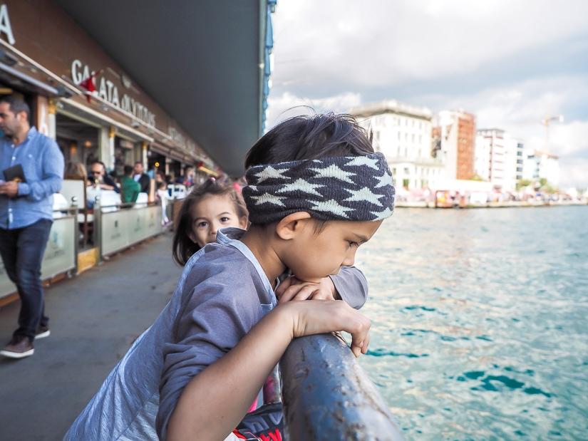 Our kids crossing Galata Bridge in Istanbul