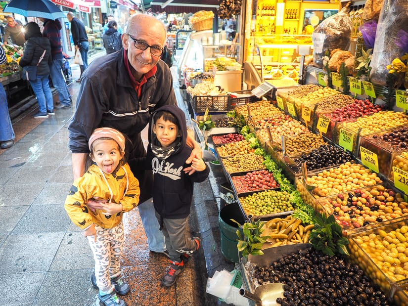 Our kids with a kind old male vendor in Istanbul