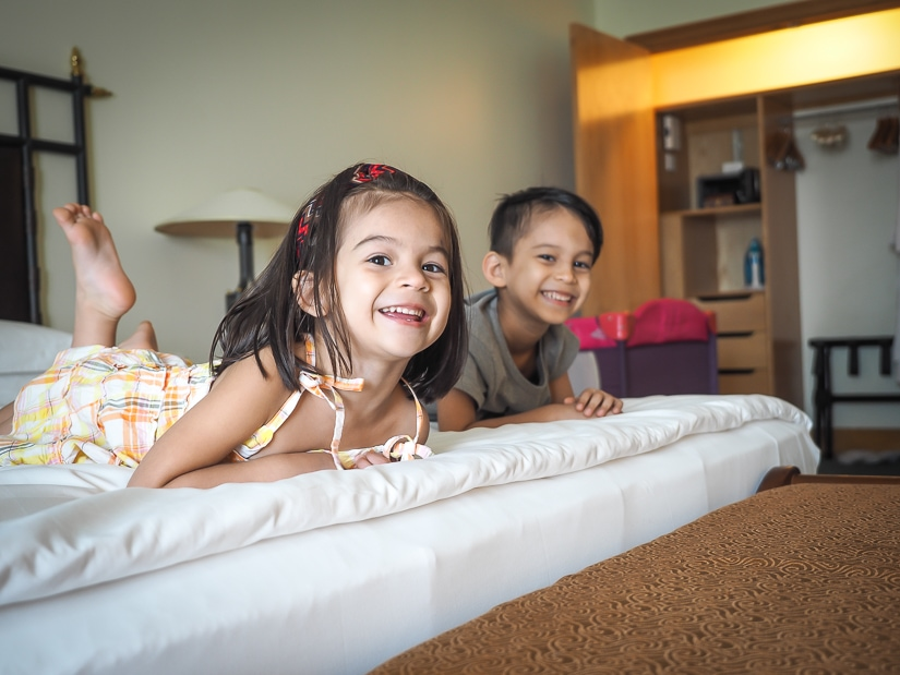 Kids laying on bed in Grand Hyatt suite