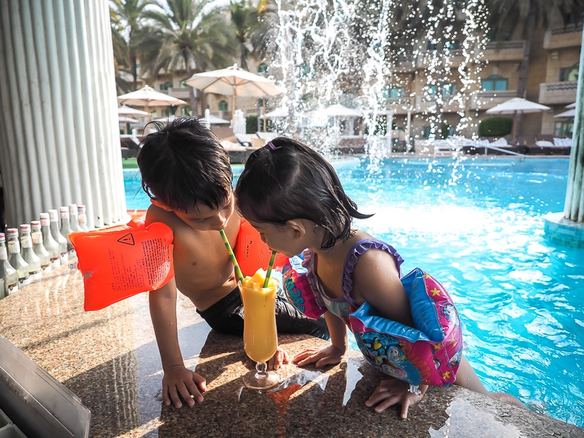 Our kids at the swim-up bar at the Grand Hyatt Muscat