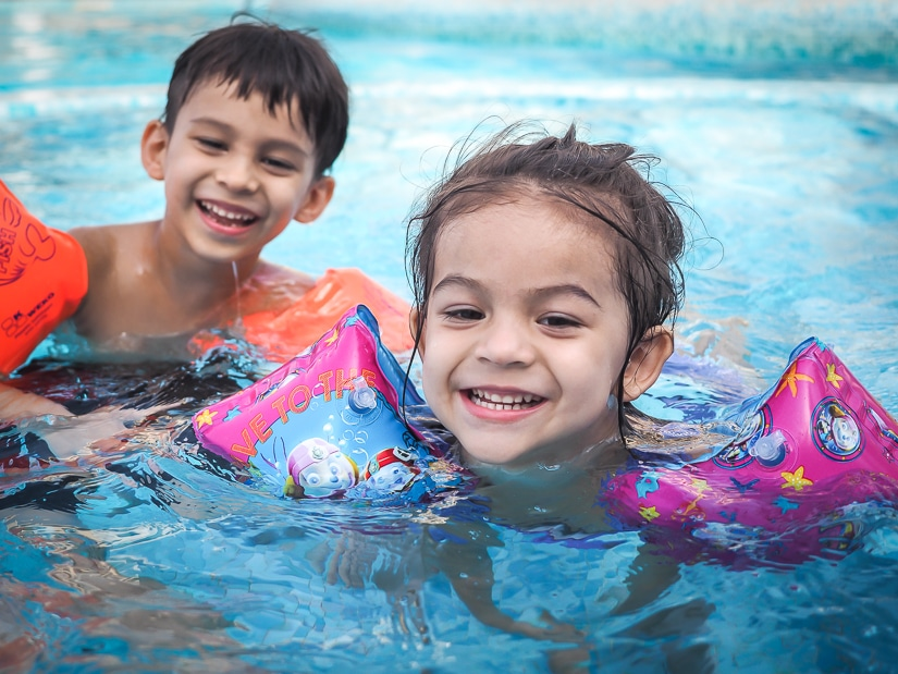 Our kids swimming in the pool at Grand Hyatt Muscat