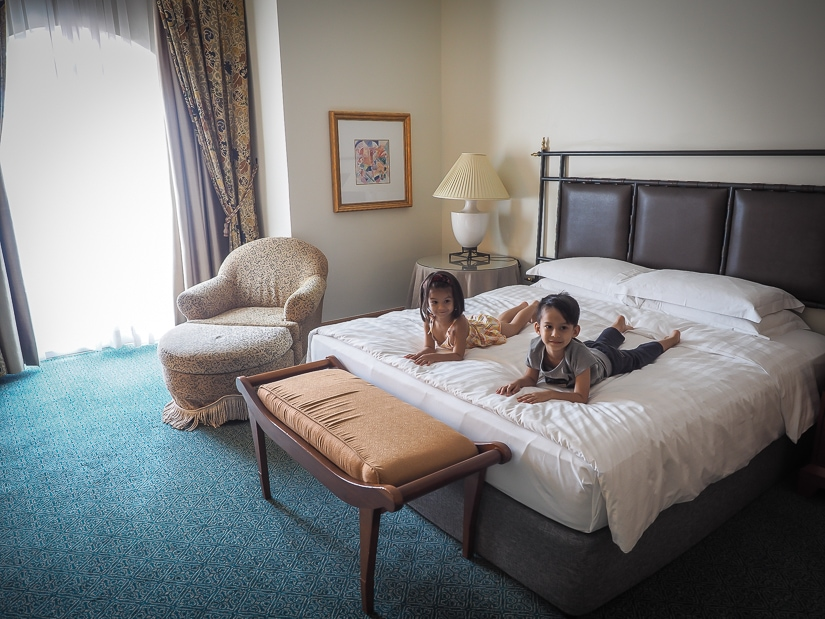 Our kids on the king size bed in grand hyatt muscat suite