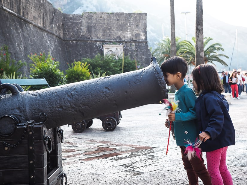 Our kids looking into a canon just outside the old city walls of Kotor Montenegro