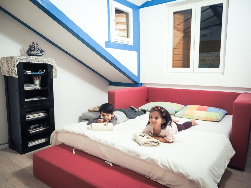 Our kids on the bed in our family friendly apartment in Kotor