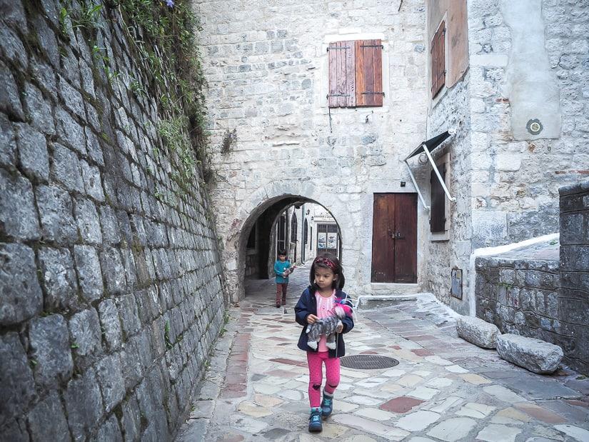 Our kids walking through a deserted street of Stari Grad (Old Town) in Kotor, Montenegro