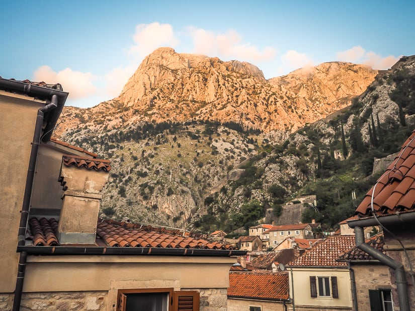 View of rooftops in Kotor and mountain in background