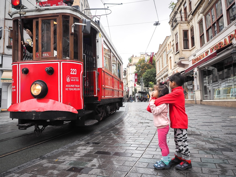 Our kids looking at the Nostalgic Tram of Istiklal Caddesi