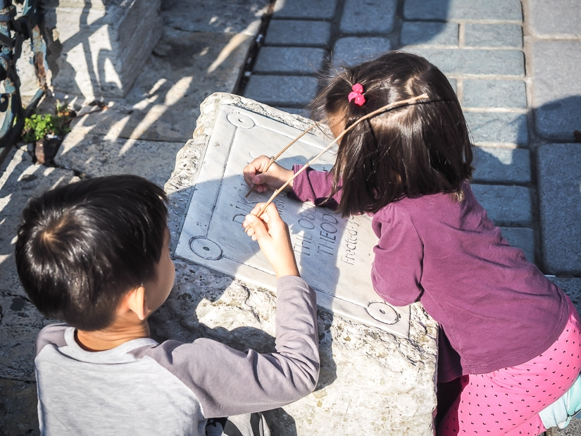 My two kids at the bottom of the obelisk in Sultanahmet Square