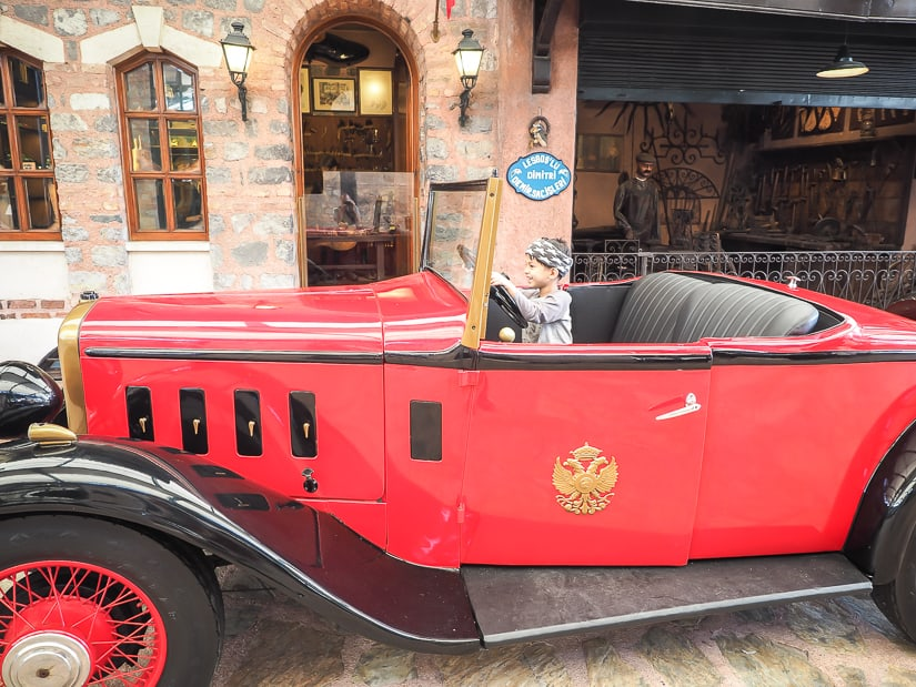 Sage riding in an antique car at Rahmi M. Koc museum in Istanbul