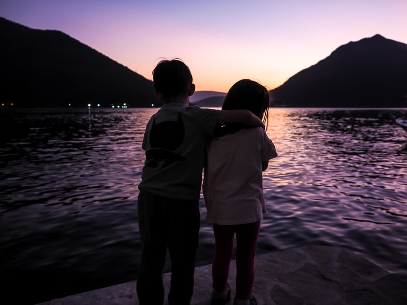 Our kids watching the sunset in Perast, Montenegro