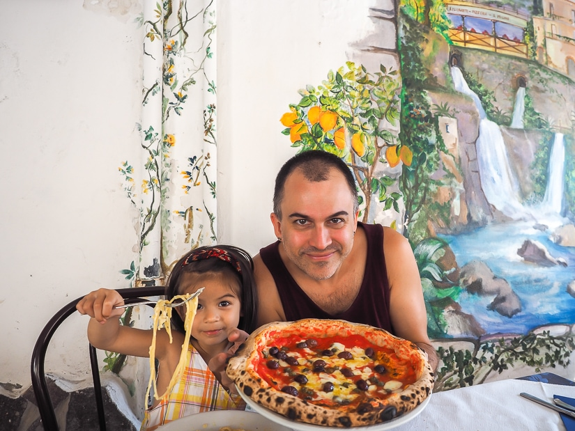 Me and my daughter eating pizza and pasta in Amalfi coast