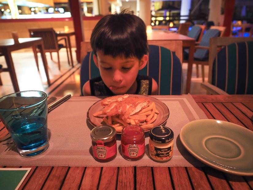 My son with his kids' meal at Marjan restaurant, Grand Hyatt Muscat