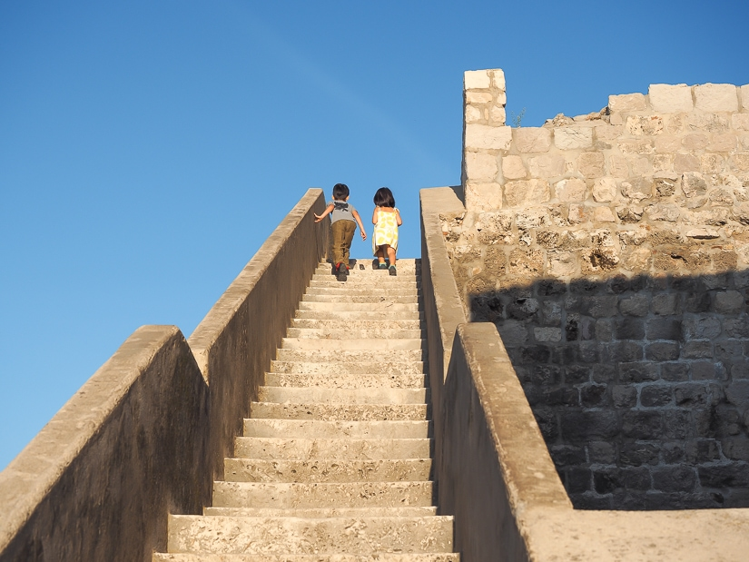 Our kids climbing up the walls around Dubrovnik