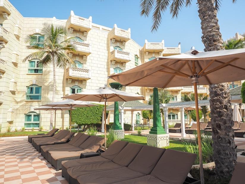 Free sun chairs at the Grand Hyatt Muscat swimming pool