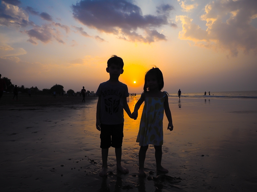 Our kids on the beach in front of the Grand Hyatt Muscat at sunset