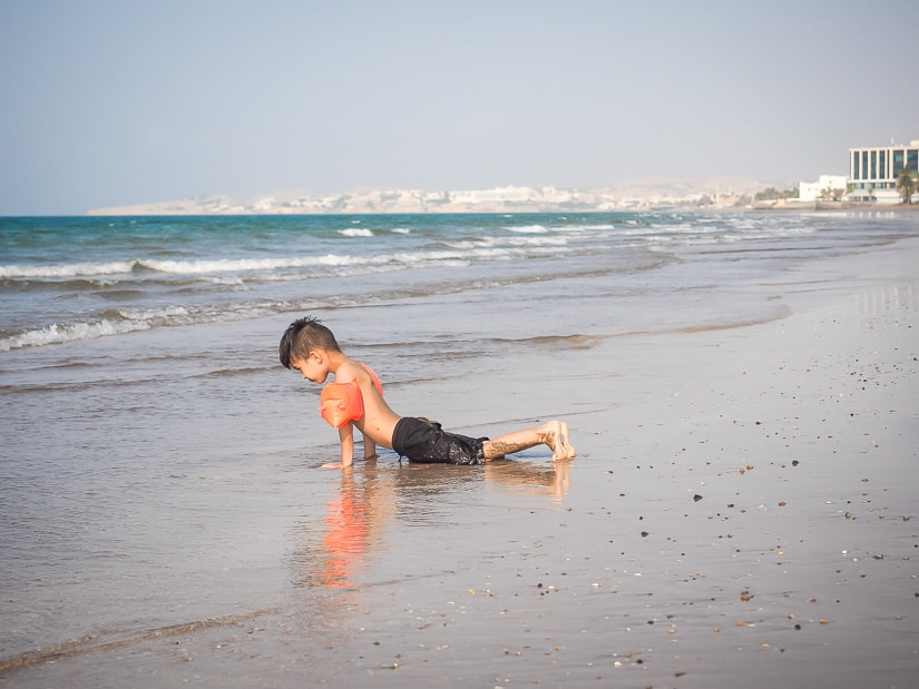 Sage doing yoga on the beach