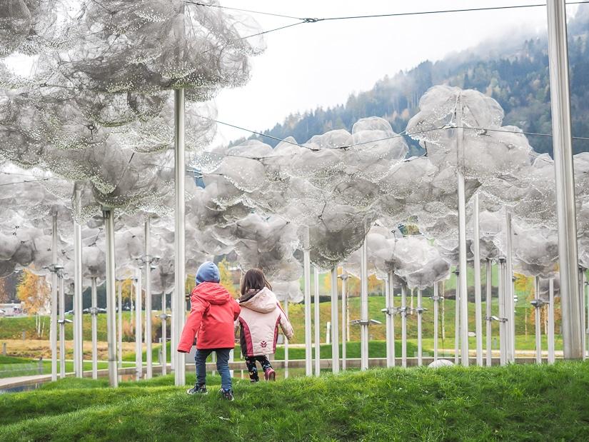 Our kids walking under clouds of crystals at Swarovski Kristallwelten