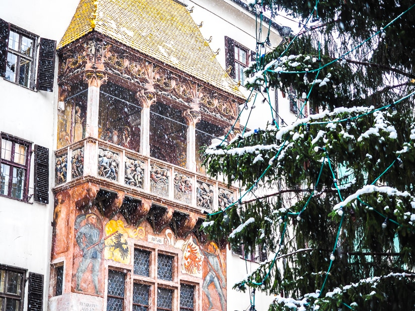 Golden Roof, Innsbruck with snow falling around it