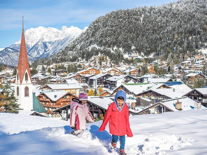 Our kids walking through deep snow in Seefeld