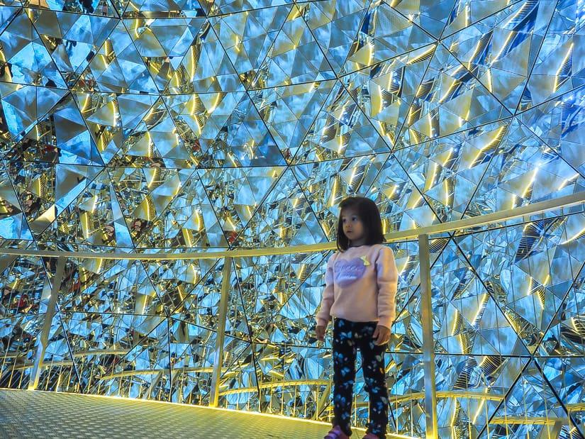 My daughter inside a crystal sphere at Swarovski Kristallwelten Innsbruck