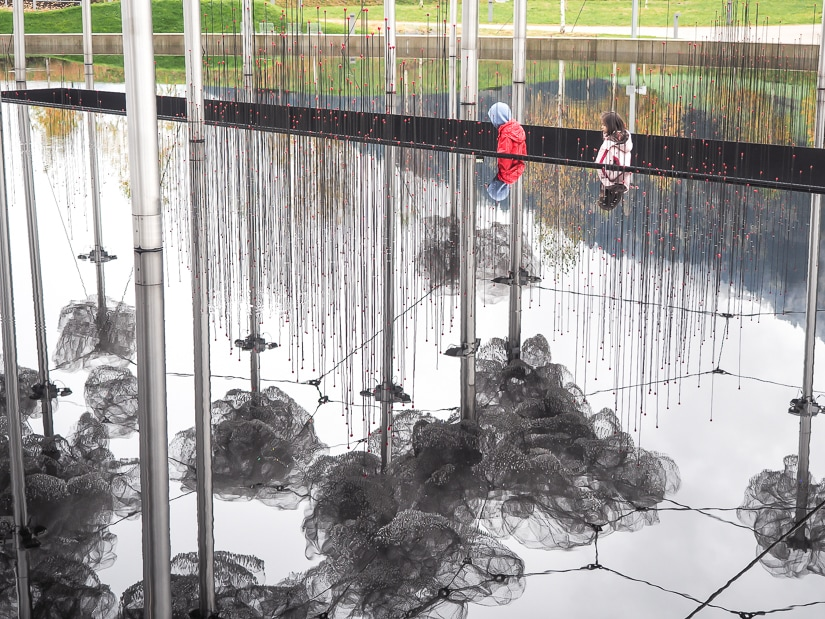 "Our children beside the ""Mirror Pool"", an outdoor art display at Swarovski Kristallwelten"
