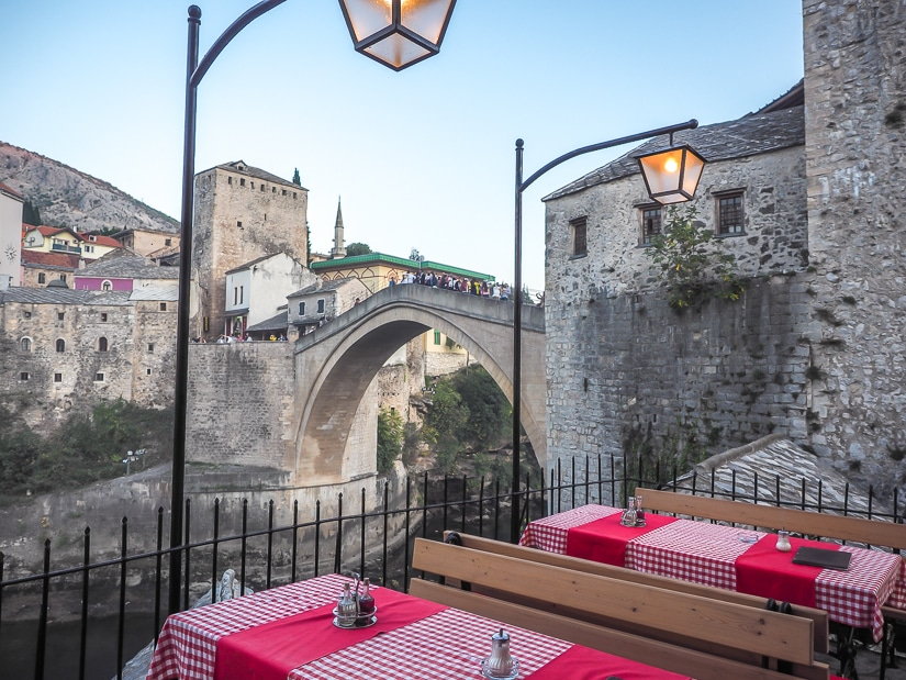 Outdoor table at Bella Vista restaurant, one of the many restaurants with a view of Stari Most bridge in Mostar