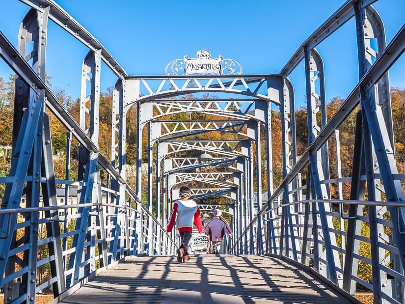 Our kids running across Mozartsteg (Mozart Bridge) in Salzburg