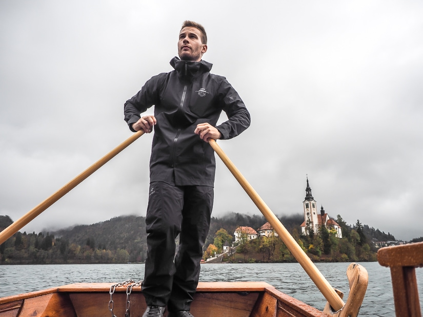 Shot of captain of a Lake Bled pletna in November rowing us to Bled Island