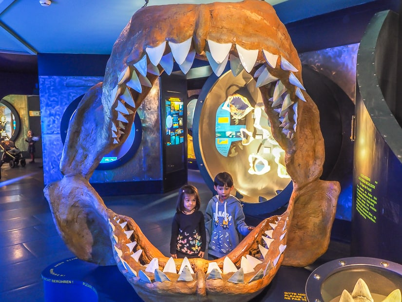 Our kids inside of a huge sea creature's jaw at Salzburg Haus der Natur