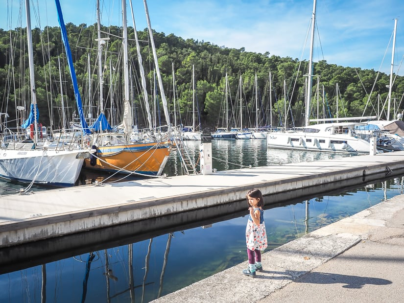 Visiting Skradin with kids: a shot of my daughter by the Skradin marina