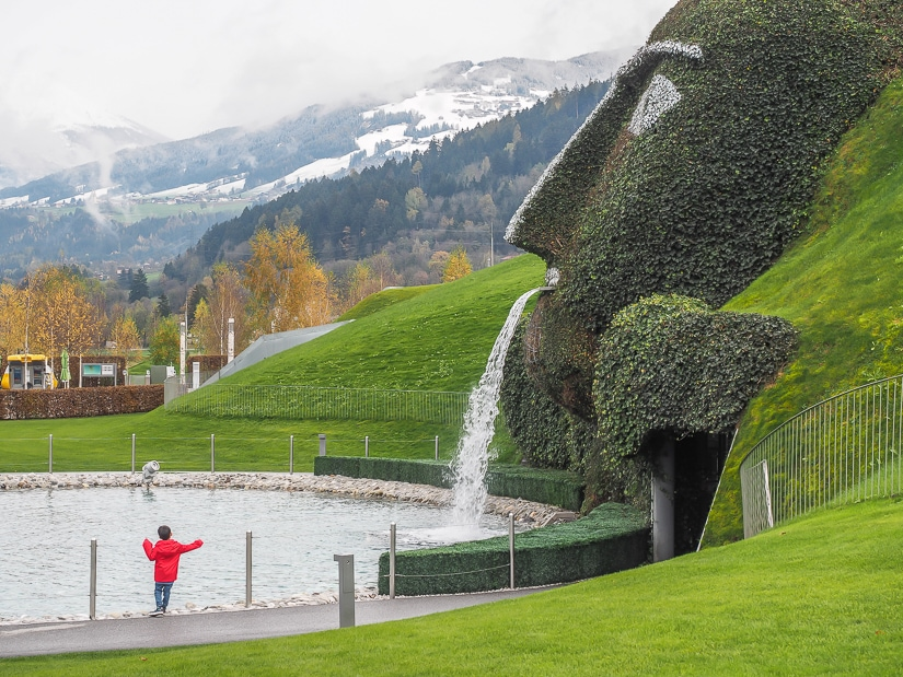 "My son in front of ""the giant"" at Swarovski Crystal Center Innsbruck"