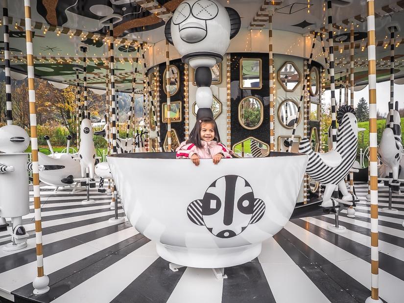 Our kids on the carousel (merry-go-round) at Swarovski Kristallwelten