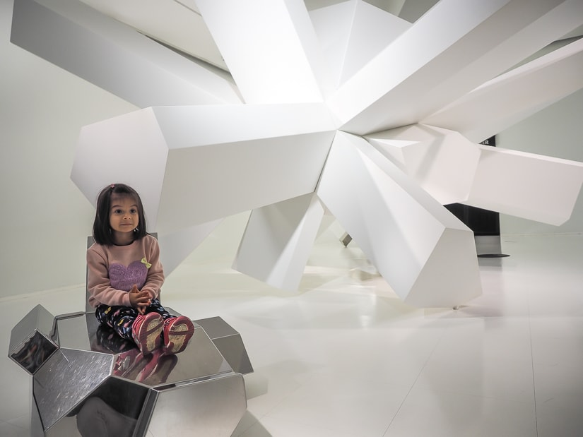 My daughter in a crystal themed 3D-printing exhibit at Swarovski Kristallwelten