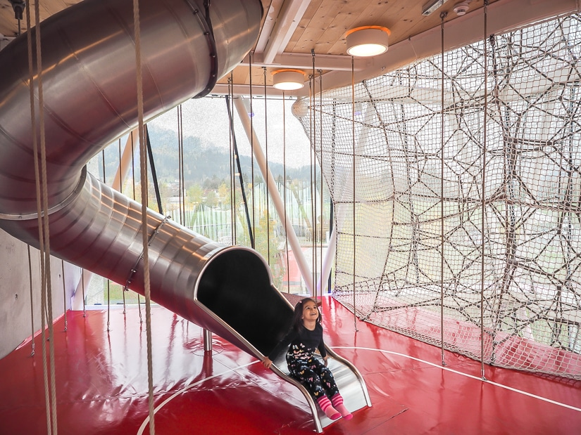 My daughter coming out of a metal slide in the Playtower at Swarovski Kristallwelten