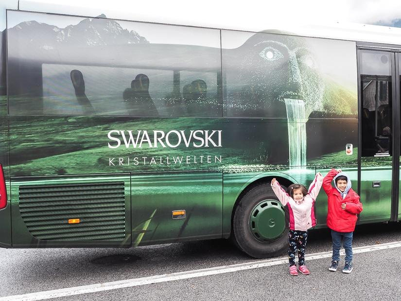 Our kids in front of the Swarovski Kristallwelten shuttle bus