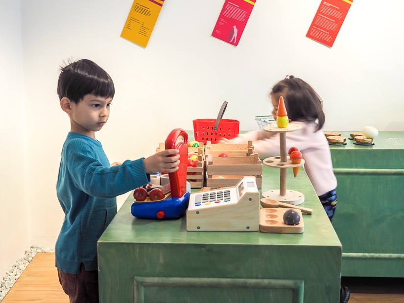 Our kids playing with toys at the Toy Museum Salzburg