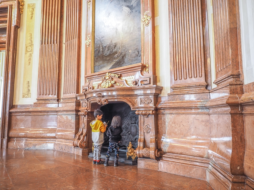 Are kids allowed in Belvedere Art Gallery? Yes! This image shows our kids in one of the many galleries, with a large fireplace and painting behind them.