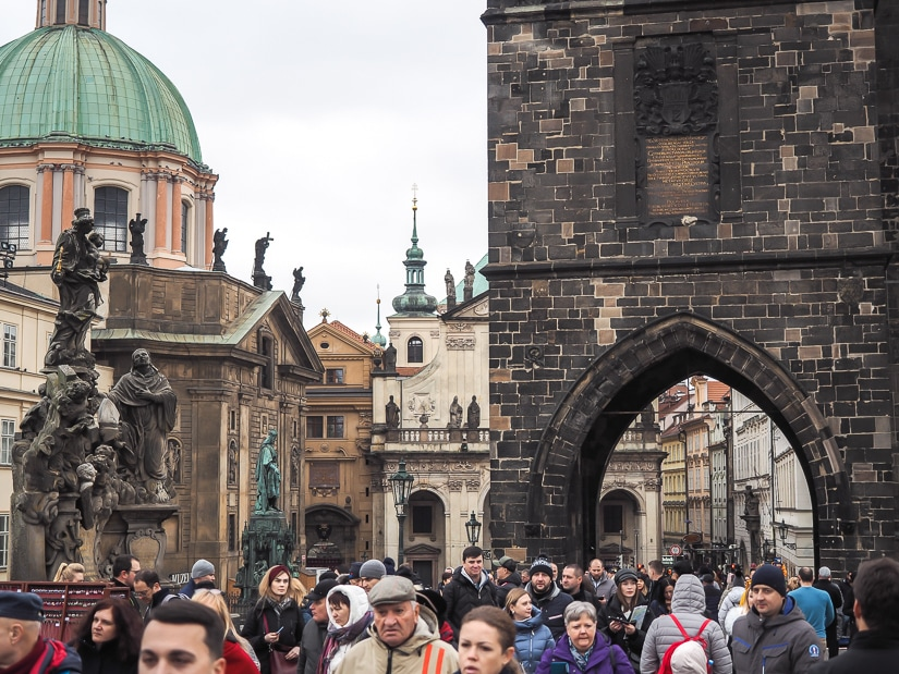 Crowds of people on Charles Bridge Prague