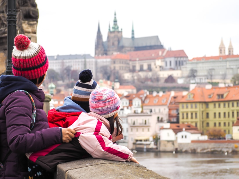 Our kids looking over the side of Charles Bridge in Prague