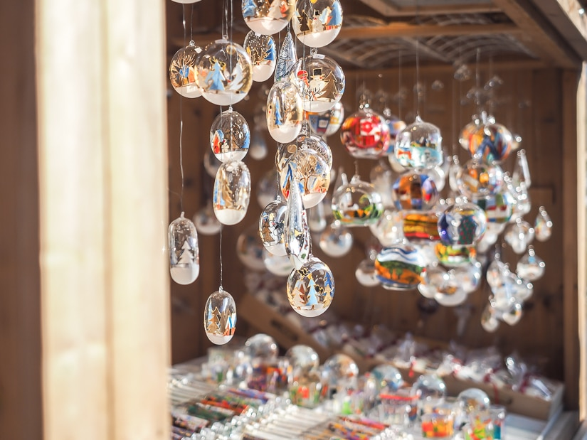 Hanging Christmas ornaments at one of the best Christmas markets in Vienna