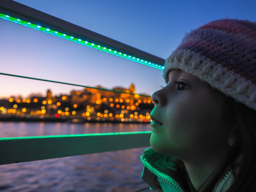 My daughter viewing Budapest from our river cruise just after sunset