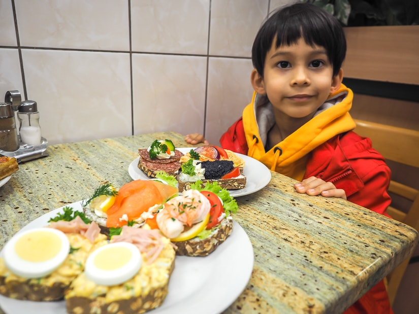 My son at a table with some sandwhiches at Open faced sandwiches at Duran Szendvics, a decent family-friendly restaurant in Budapest
