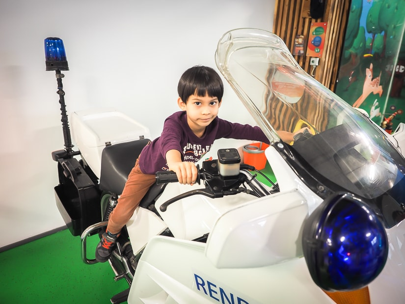 My son riding a police motorcycle at Minipolisz, the best play center for kids in Budapest