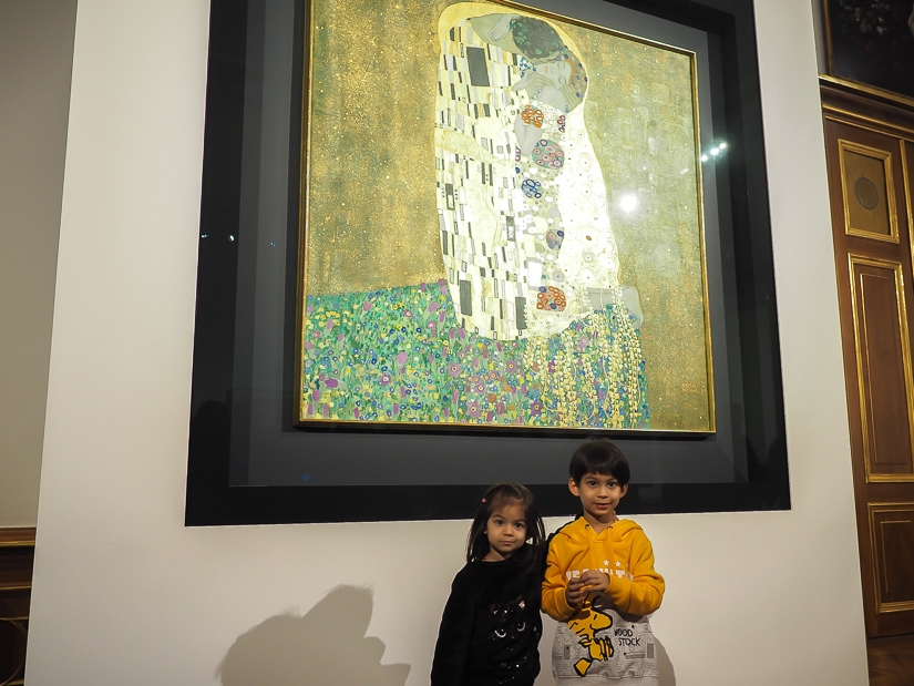 """Our kids standing in front of """"The Kiss"""", a painting by Klimt, in the Belvedere Art Galley in Vienna"""