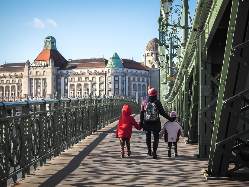My wife walking with our kids across Liberty Bridge toward Gellert Spa in Budapest