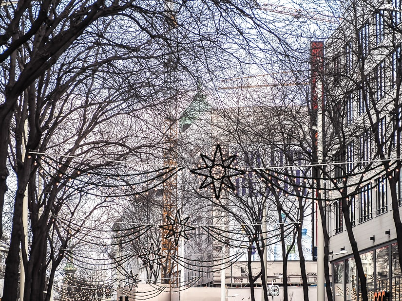 Trees and Christmas decorations on Mariahilfer Strasse, the best shopping street in Vienna