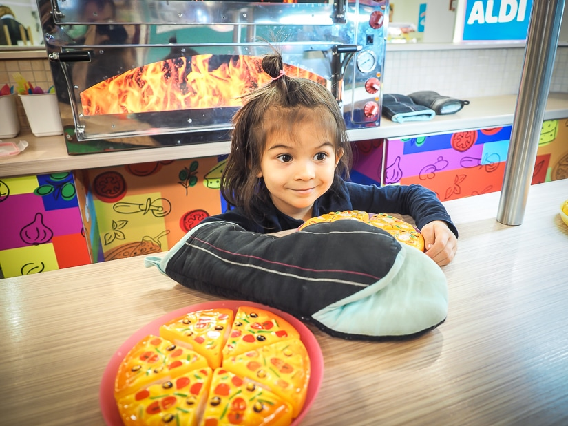 Kids making pretend pizza at MiniPolisz Budapest, one of the best places to visit in Budapest with kids
